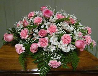 Pink & white casket spray  from Krupp Florist, your local Belleville flower shop