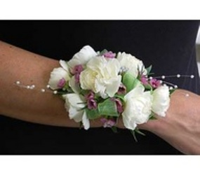 Carnation corsage w/waxflower from Krupp Florist, your local Belleville flower shop